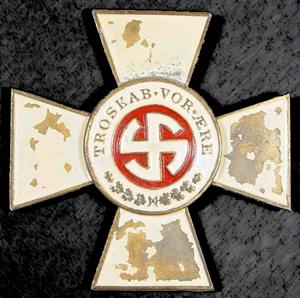 Emblem fra Schalburgkorpset - med teksten Troskab vor Ære